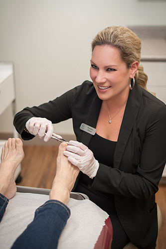 Dr. Gorham treating a patient at Azilda Family Foot Care in Azilda, ON