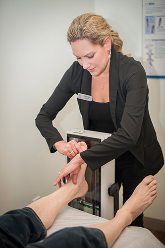 Dr. Gorham scanning the heel of a patient at Azilda Family Foot Care in Azilda, ON